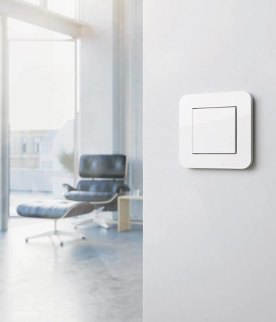 Gira E3 Pure White switch with Eames chair