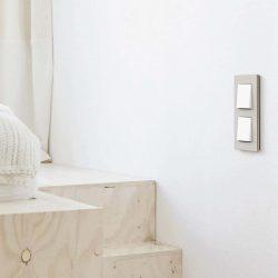 Gira Esprit Linoleum Plywood Light Grey switch in bedroom
