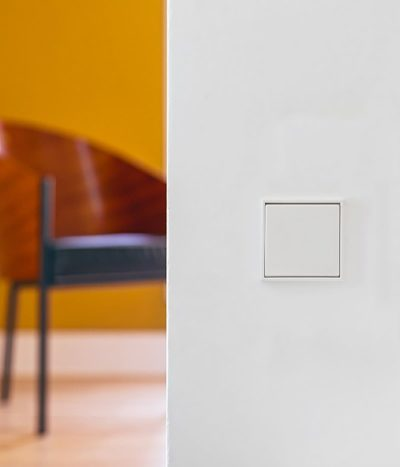 Jung LS990 white light switch on wall
