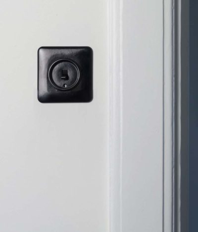 THPG Bakelite toggle light switch on kitchen wall